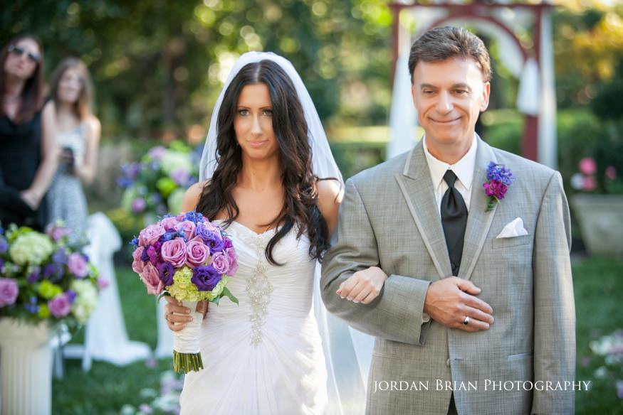 bride walking down aisle with father at wedding ceremony at knowlton mansion