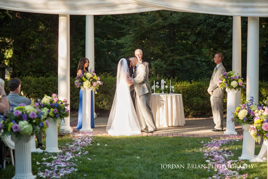 bride and groom kiss at knowlton mansion wedding ceremony