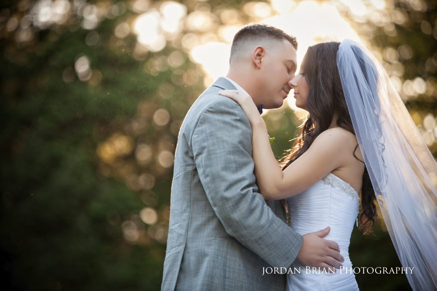 bride and groom kiss at knowlton masion wedding