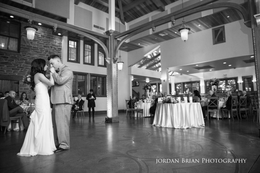 groom kissing bride during first dance at knowlton mansion