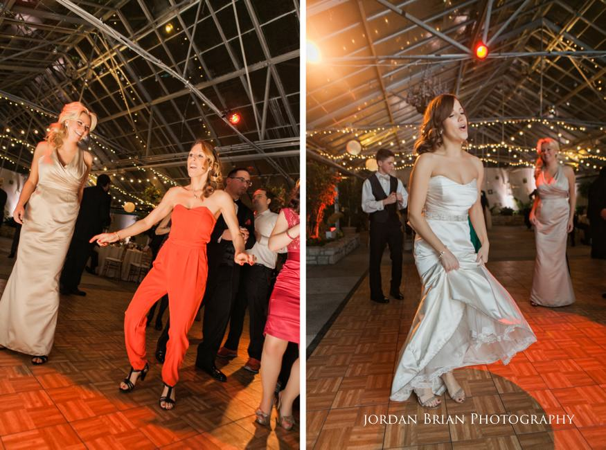 Guests and bride dancing at Fairmount Park Horticulture Center wedding reception.