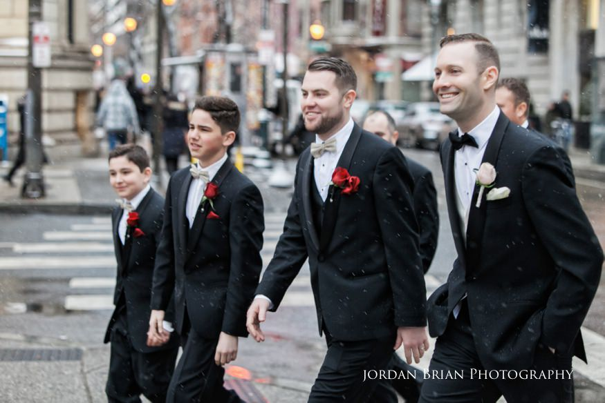 Groomsmen walking photos in Rittenhouse Square befor their Fairmount Park Horticulture Center Wedding