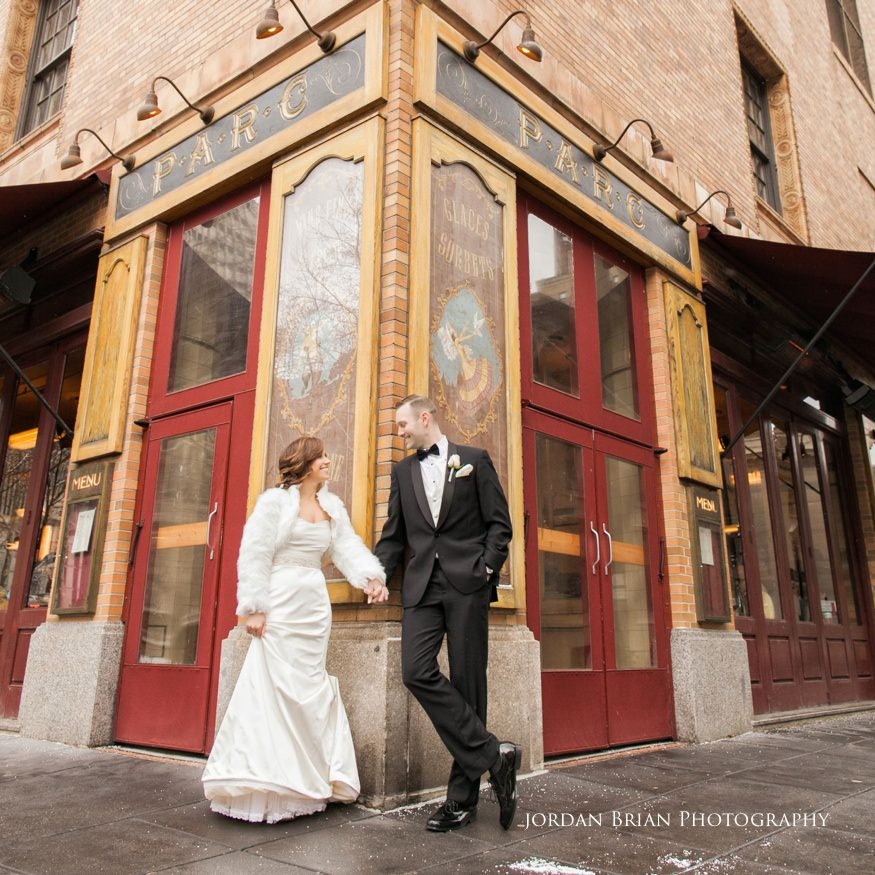 Bride and groom photo in front of Parc restaurant in Rittenhouse Square