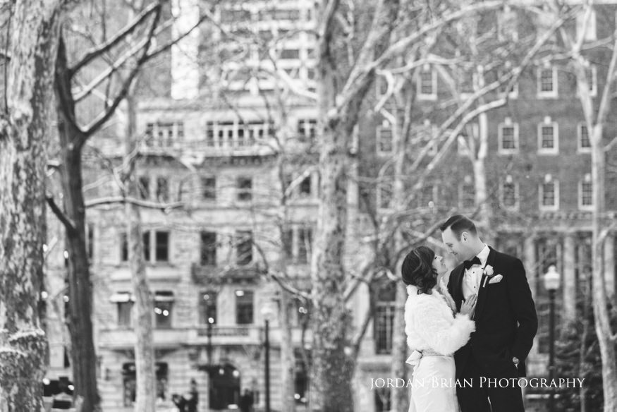Snowy Bride and groom portraits in Rittenhouse Square befor their Fairmount Park Horticulture Center wedding.