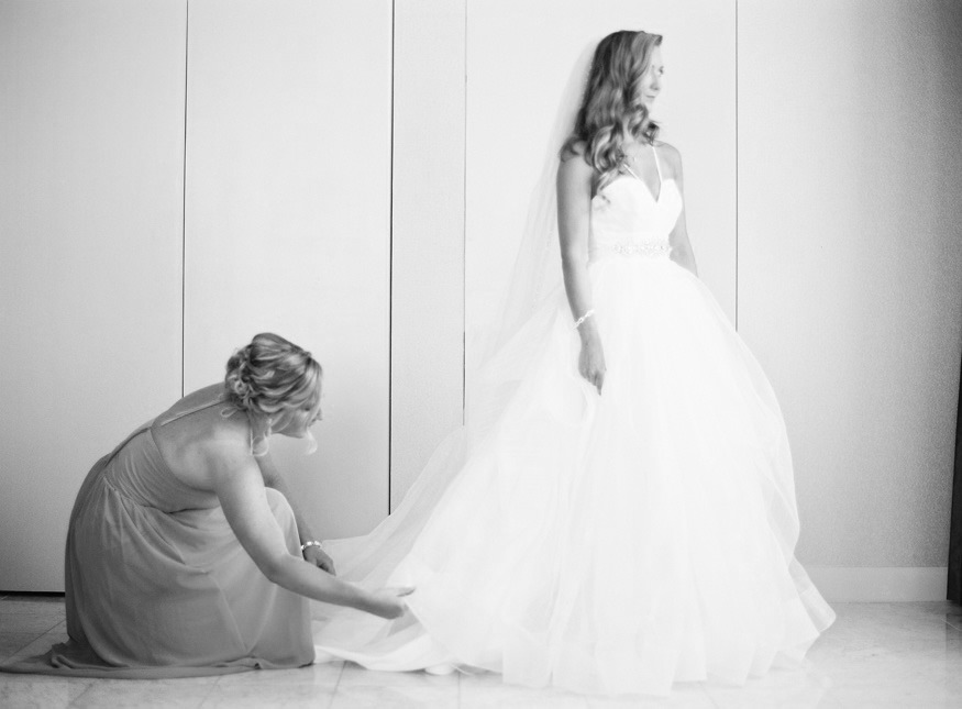 Bride putting on her Hayley Paige wedding dress before her Crystal Tea Room wedding.