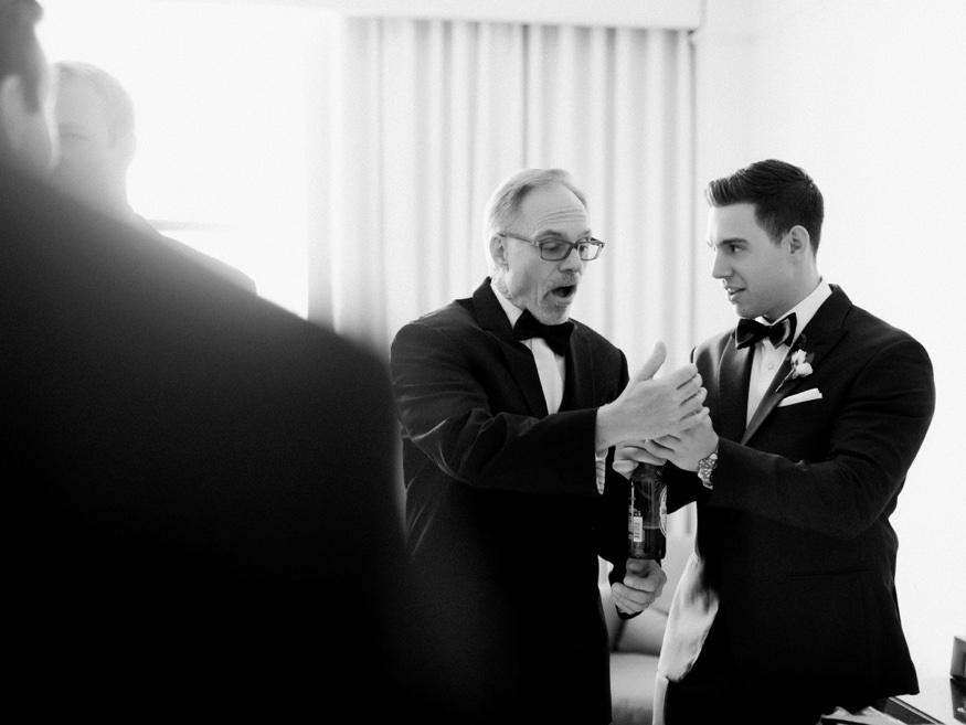 Groom getting ready before Crystal Tea Room summer wedding.