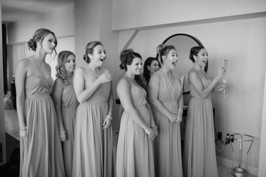 Bridesmaids seeing bride for the first time before Crystal Tea Room summer wedding.