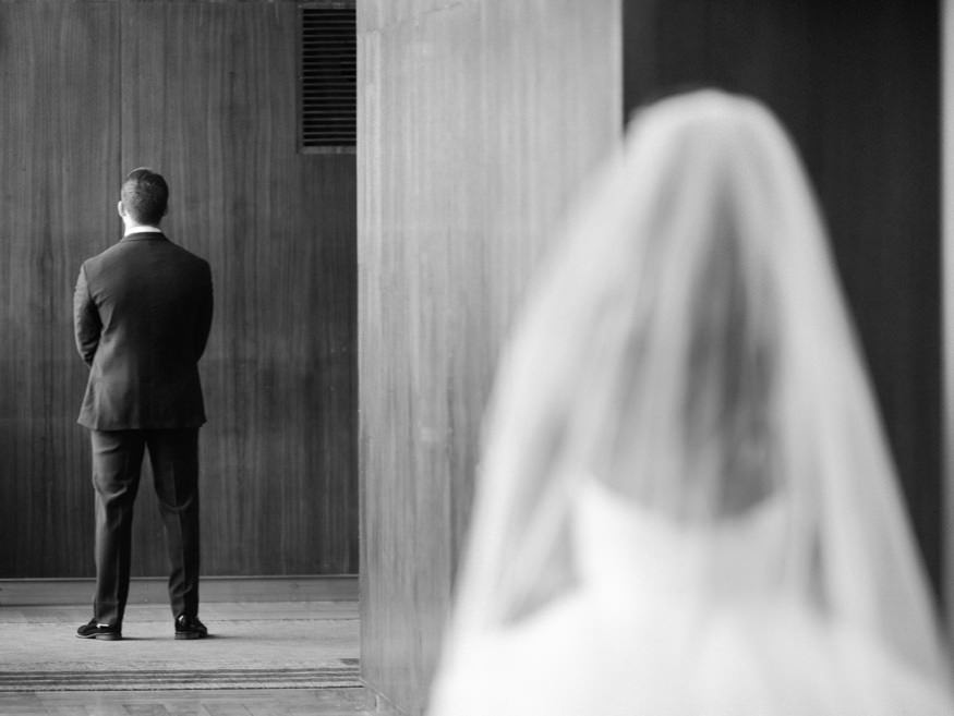 Bride and groom first look at Loews Hotel before Crystal Tea Room summer wedding.