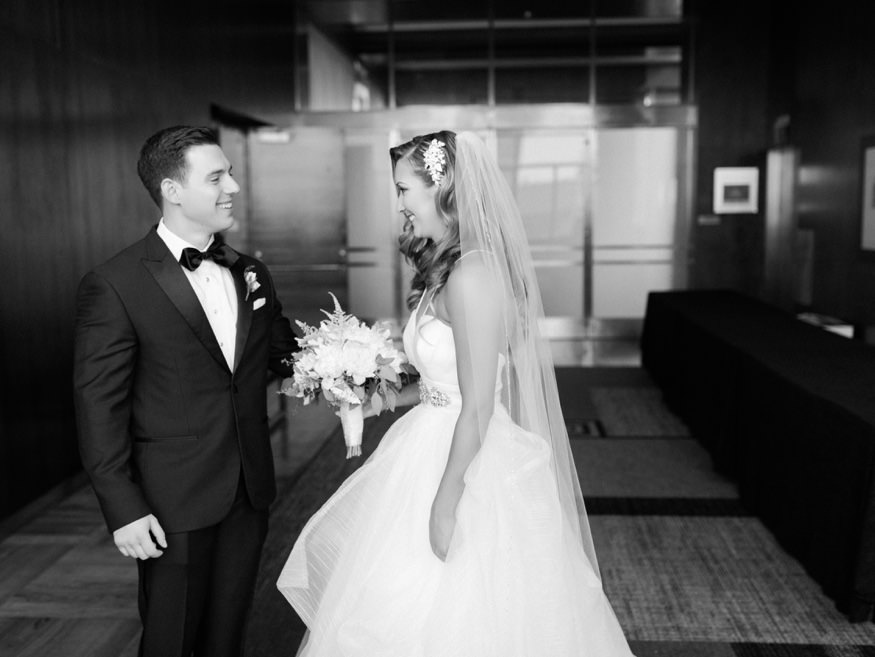 Bride and groom first look at Loews Hotel before Crystal Tea Room summer wedding.