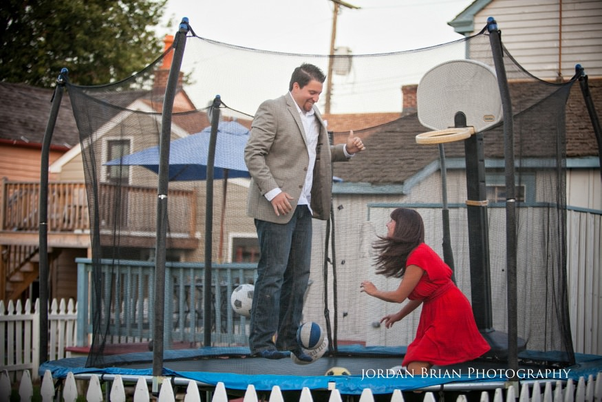 couple on trampoline for chesapeake city engagement session