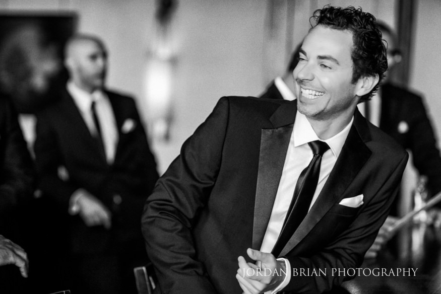 Black and white film portraits of Groom getting ready before Philadelphia Bellevue Hotel Wedding.