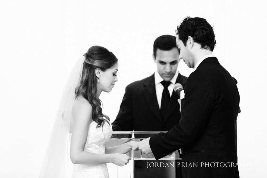 Bride and groom exchange rings at Bellevue Hotel wedding ceremony.