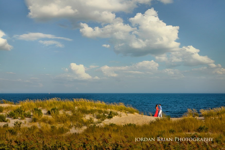 LBI engagement session coupe on sand dune with ocean in background