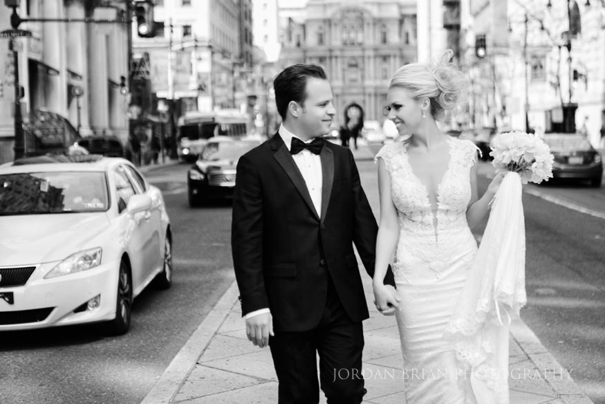 bride and groom portraits infront of city hall before curtis center wedding