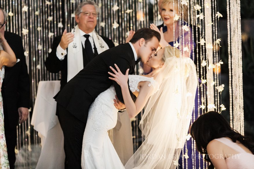 bride and groom kiss at curtis center wedding ceremony in philadelphia