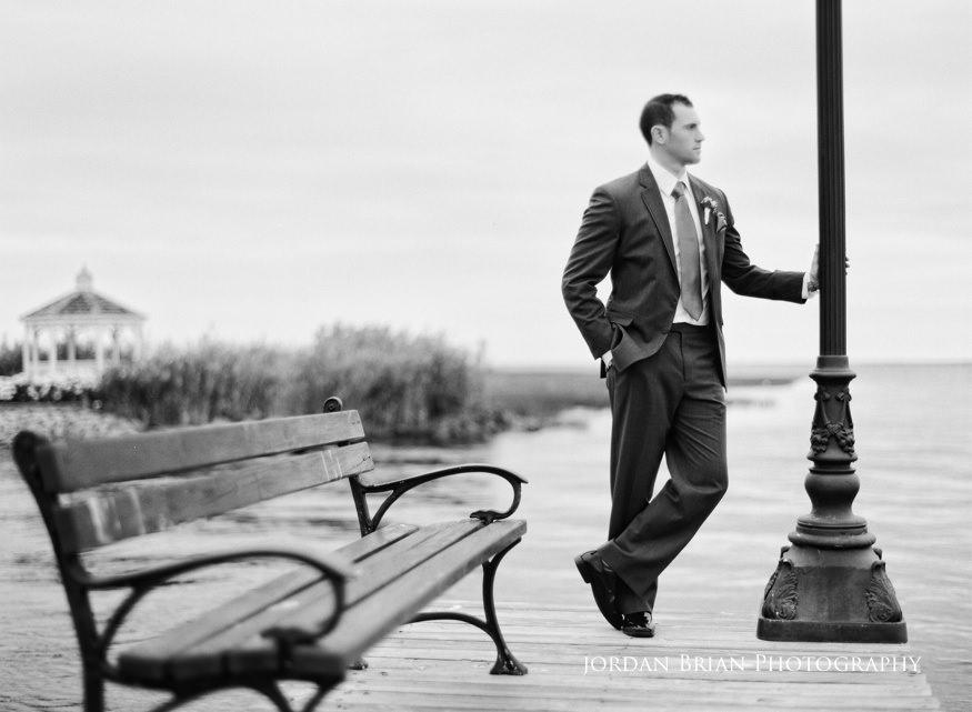 bonnet island estate groom portrait on dock in black and white