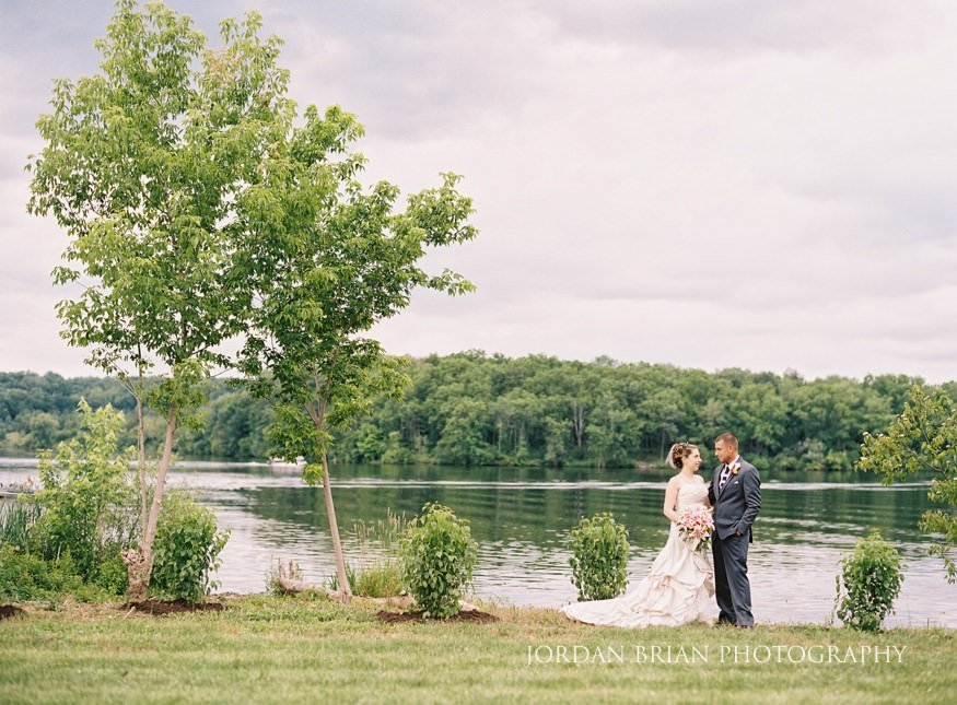 bride and groom portraits at lake house in wedding