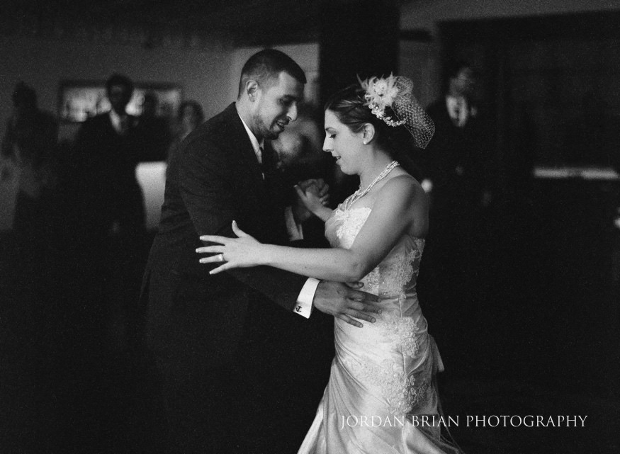 bride and groom first dance at lake house inn