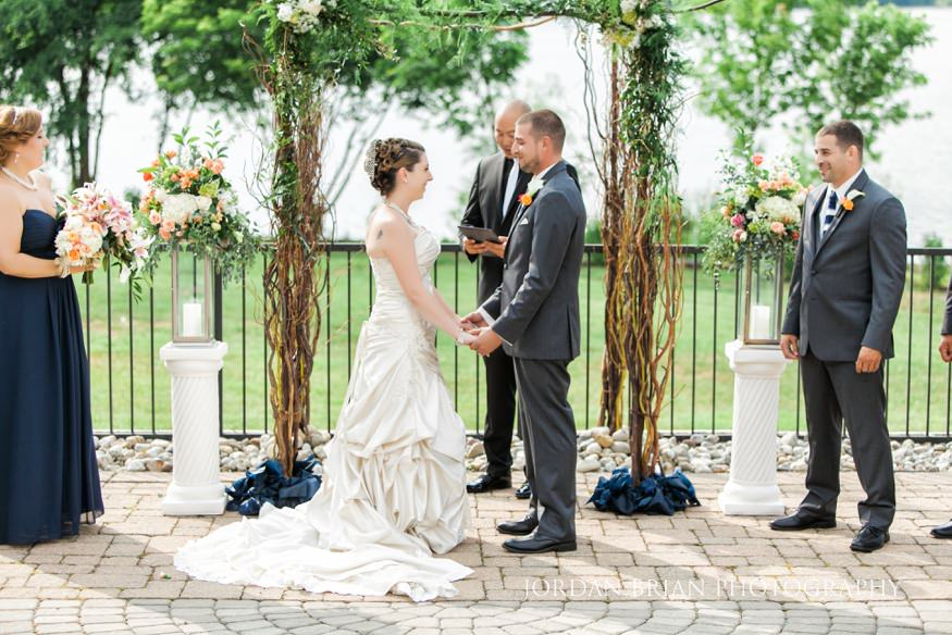 bride and groom outdoor wedding ceremony lakehouse inn