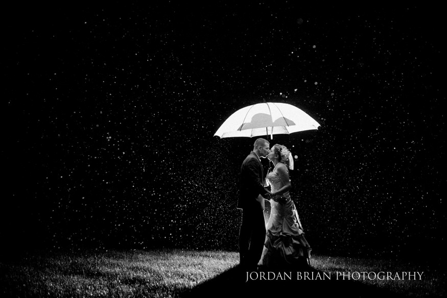 bride and groom portrait at night in the rain
