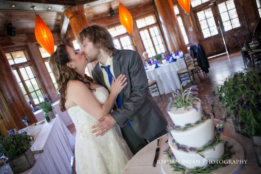 Kiss after cake cutting at Rat's Grounds for Sculpture wedding
