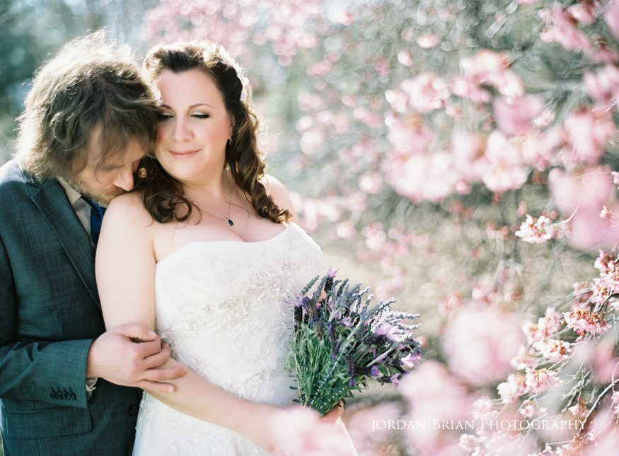 Bride and groom portraits with spring flowers at Grounds for Sculpture wedding