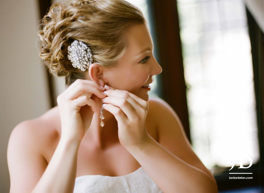 castle at skylands manor wedding bride putting earrings
