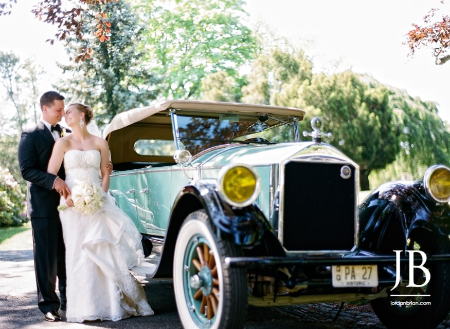 castle at skylands manor wedding bride and groom photo with vintage car