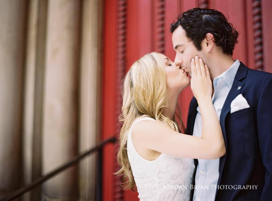 Rittenhouse Square engagement photo of couple in front of red church doors
