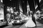 Bride and Groom in front of city hall at night