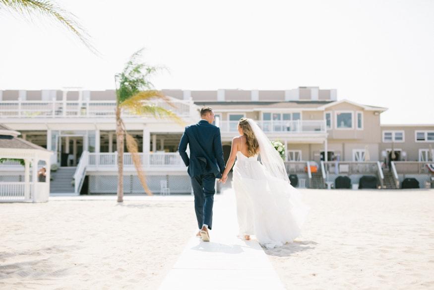 Best Jersey Shore wedding venue windows on the water sea bright couple on beach